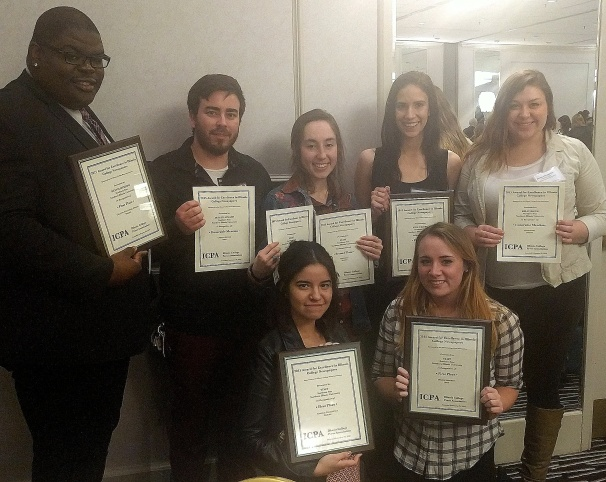 Northern Star editors display their awards, which include first place for general excellence and best online news site, at the annual Illinois College Press Association luncheon on Feb. 22 in Chicago.